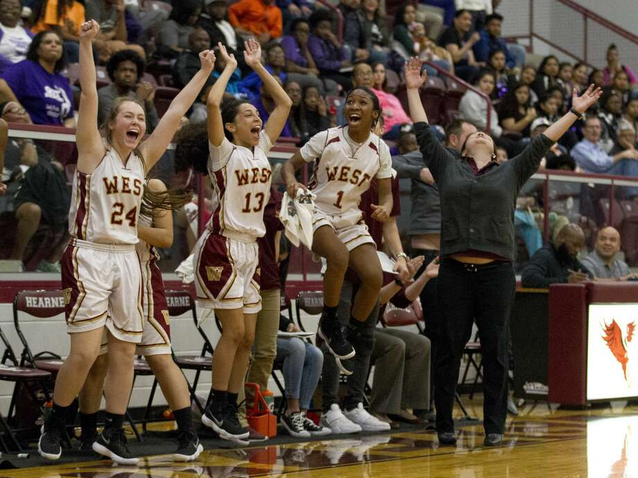 Magnolia West head coach Sarah Simmons reacts beside players after defeating Waco University 69-59 during a Region III-6A area high school playoff game at Hearne High School, Friday, Feb. 16, 2018, in Hearne. Photo: Jason Fochtman/Houston Chronicle