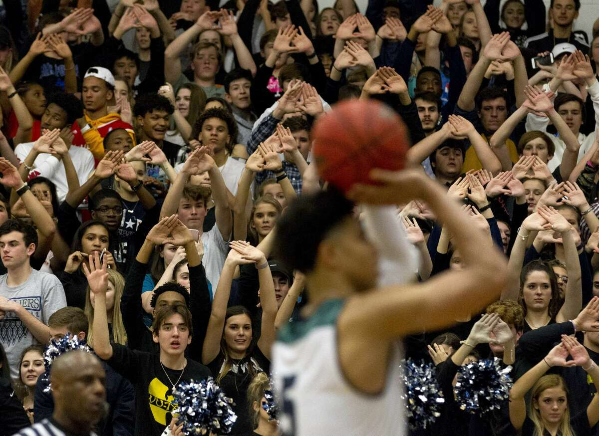 College Park fans await a free throw by guard Quentin Grimes (5) in the closing seconds of the fourth quarter of a District 12-6A high school basketball game at College Park High School, Friday, Feb. 9, 2018, in The Woodlands.