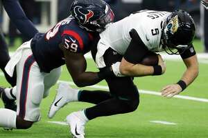 Houston Texans outside linebacker Whitney Mercilus (59) stops Jacksonville Jaguars quarterback Blake Bortles (5) for a 1-yard gain after he was forced out of the pocket during the second quarter of an NFL football game at NRG Stadium on Sunday, Dec. 30, 2018, in Houston.