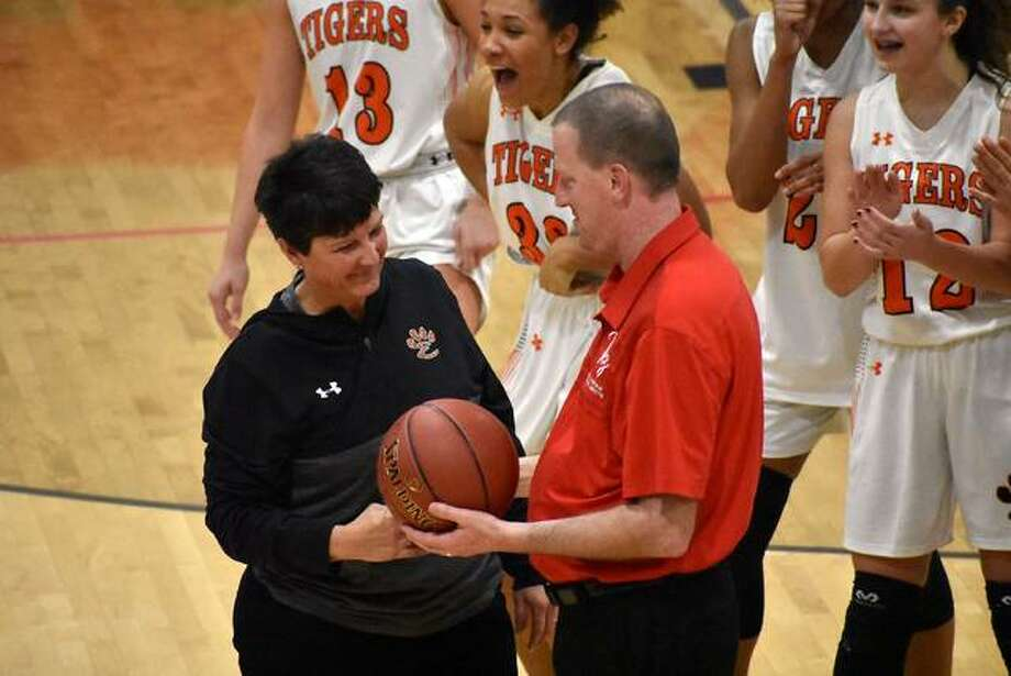 Edwardsville coach Lori Blade is presented the game ball after winning her 700th game on Wednesday. Photo: Matt Kamp/Intelligencer