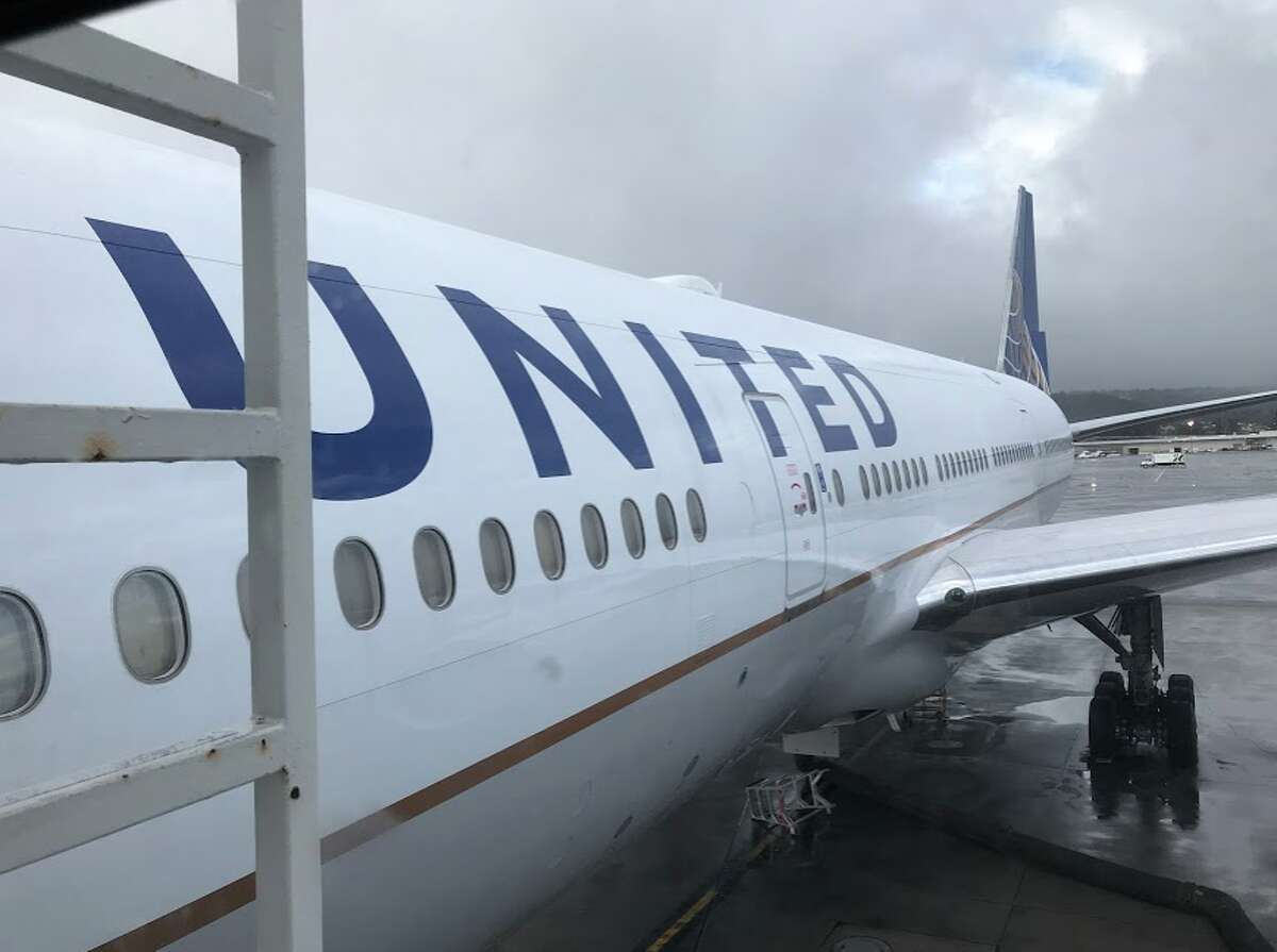 In early December, flights to NYC are cheap. Here we are boarding a 777-200 for the 6-hour flight SFO-EWR for which I paid just $298 round trip during the