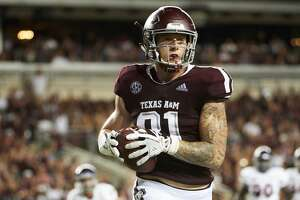 COLLEGE STATION, TX - AUGUST 30:  Jace Sternberger #81 of the Texas A&M Aggies scores on a 7 yard touchdown reception against the Northwestern State Demons during the first half of a football game at Kyle Field on August 30, 2018 in College Station, Texas.  (Photo by Cooper Neill/Getty Images)