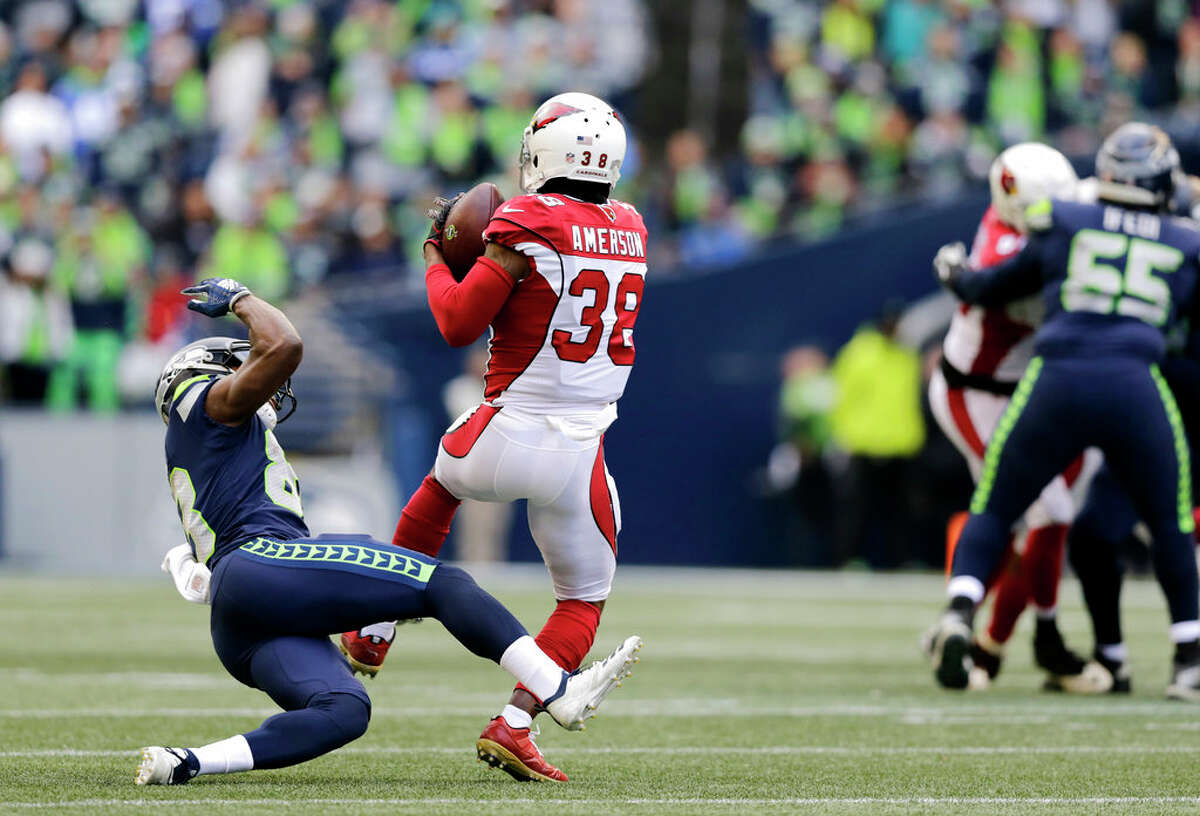 Arizona Cardinals' David Amerson (38) intercepts the ball in front of Seattle Seahawks' David Moore during the first half of an NFL football game, Sunday, Dec. 30, 2018, in Seattle. (AP Photo/John Froschauer)