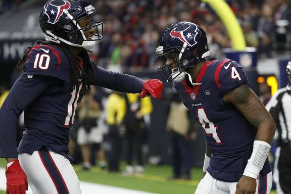 Houston Texans quarterback Deshaun Watson (4) celebrates with wide receiver DeAndre Hopkins (10) after Watson's touchdown during the second quarter of an NFL football game at NRG Stadium, Sunday, Dec. 30, 2018, in Houston.