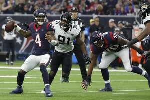 Houston Texans quarterback Deshaun Watson (4) is pressured by Jacksonville Jaguars defensive end Yannick Ngakoue (91) during the second quarter of an NFL football game at NRG Stadium, Sunday, Dec. 30, 2018, in Houston.