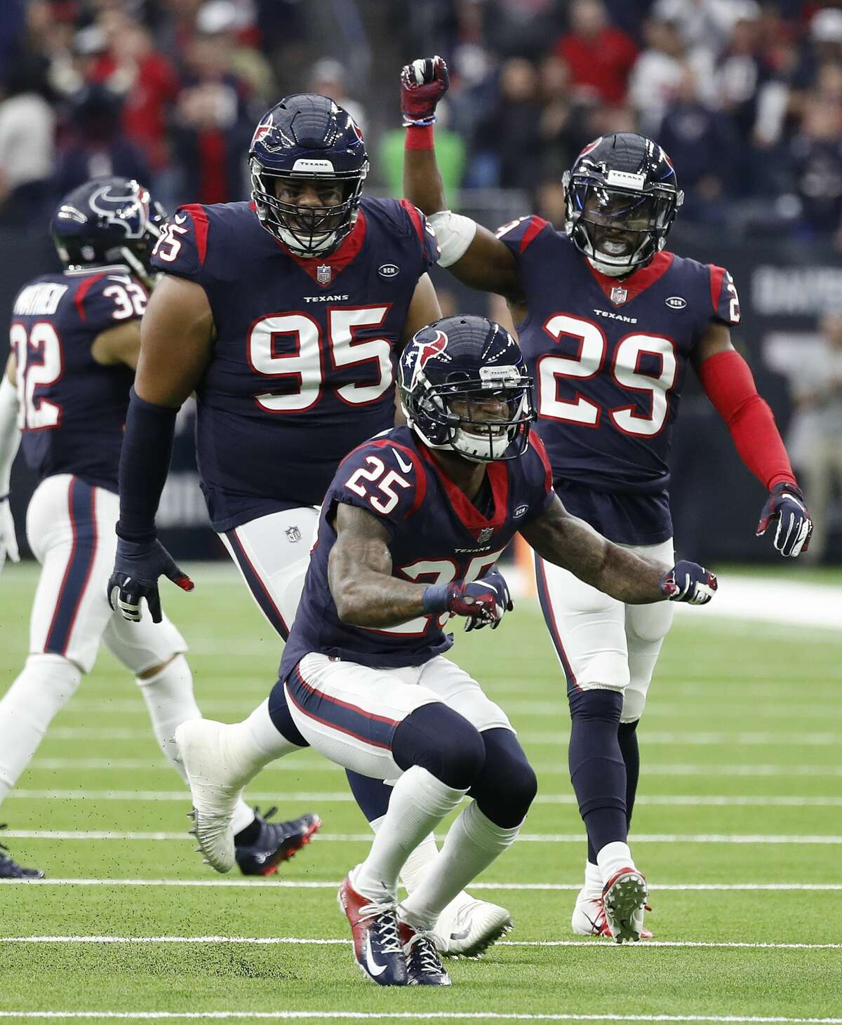 Houston Texans strong safety Kareem Jackson (25) reacts after bringing down Jacksonville Jaguars running back Carlos Hyde (34) for a fourth-down during the third quarter of an NFL football game at NRG Stadium, Sunday, Dec. 30, 2018, in Houston.