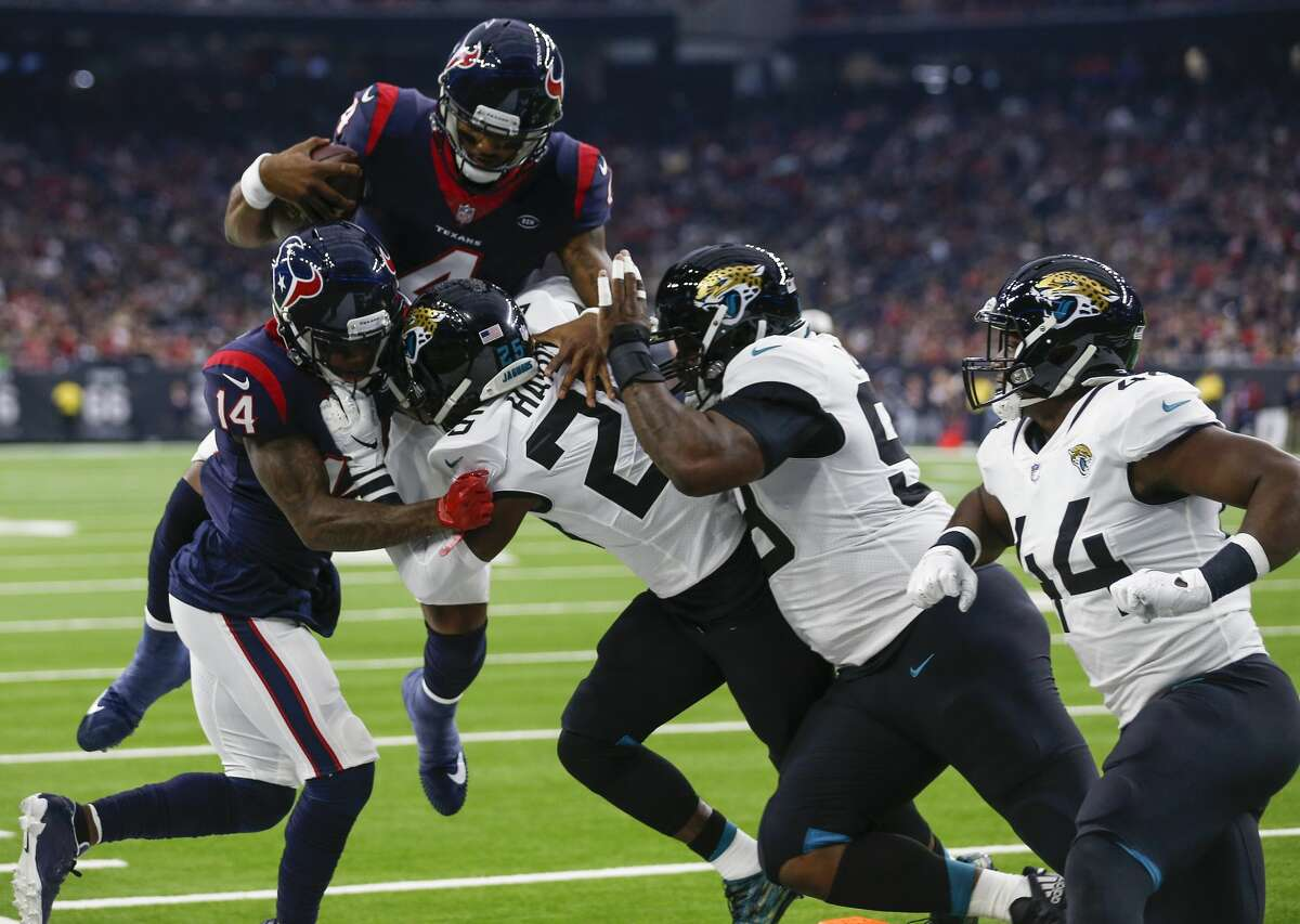 Houston Texans quarterback Deshaun Watson (4) leaps toward the end zone and is stopped short by Jacksonville Jaguars defensive back D.J. Hayden (25) near the goal line during the first quarter of an NFL football game at NRG Stadium on Sunday, Dec. 30, 2018, in Houston.