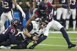 Houston Texans linebacker Duke Ejiofor (53) and strong safety Justin Reid (20) stops Jacksonville Jaguars quarterback Blake Bortles (5) short of a first time as he was forced out of the pocket during the second quarter of an NFL football game at NRG Stadium on Sunday, Dec. 30, 2018, in Houston.