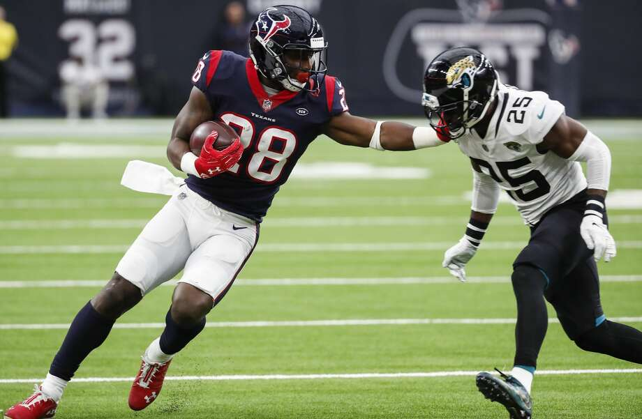 Houston Texans running back Alfred Blue (28) runs around end chased down by Jacksonville Jaguars defensive back D.J. Hayden (25) during the third quarter of an NFL football game at NRG Stadium on Sunday, Dec. 30, 2018, in Houston. Photo: Brett Coomer/Staff Photographer
