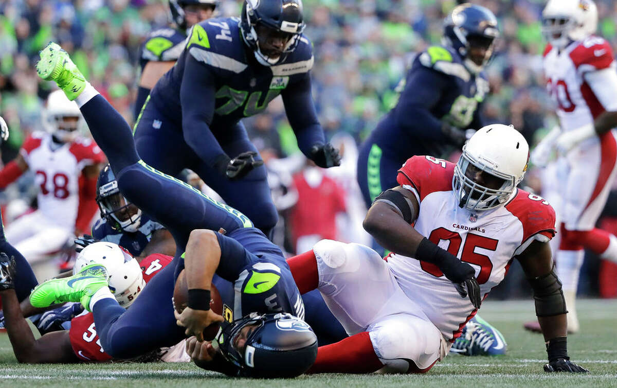 SEAHAWKS' OFFENSIVE LINE DIDN'T LOOK SHARP With injuries and shuffling parts on the offensive line Sunday, the group turned out its worst performance since the beginning of the season. Russell Wilson was sacked six times by the Cardinals, including four times in the first half. Ethan Pocic filled in for the injured J.R. Sweezy at left guard and Germain Ifedi, the starting right tackle, slid over to right guard due to D.J. Fluker's limited availability. George Fant took Ifedi's place as the starting RT. The experiment didn't work Sunday and head coach Pete Carroll told reporters post game that he expects to have his original starting o-line, at full strength and at their original positions, against the Cowboys next week. Ifedi, however, didn't want to make any excuses for the O-line's showing against Arizona.