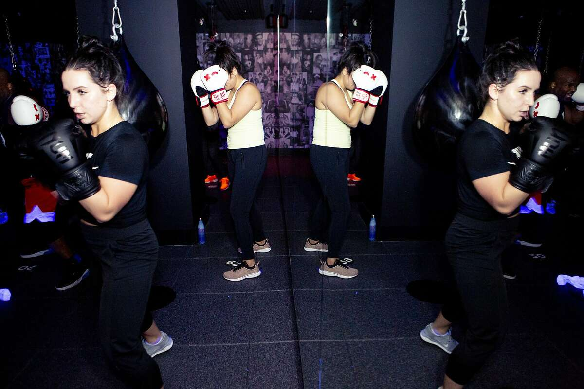 Participants during a class at Rumble Boxing on Friday, Dec. 28, 2018, in San Francisco, Calif. The gym is located at 180 Sansome St.