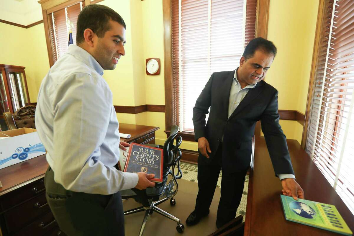 Taral Pate (left) helps Fort Bend's newly elected County Judge, K.P. George, unpack in his office Friday, Dec. 28, 2018, in Richmond. George, an immigrant from South India, takes over as county judge, the top elected position in January.