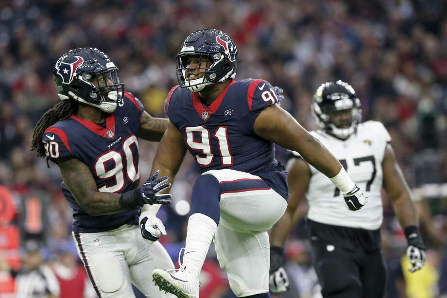 Carlos Watkins (91) of the Houston Texans celebrates after a sack in the fourth quarter against the Jacksonville Jaguars at NRG Stadium on December 30, 2018 in Houston, Texas. Photo: Tim Warner, Stringer / Getty Images / 2018 Getty Images