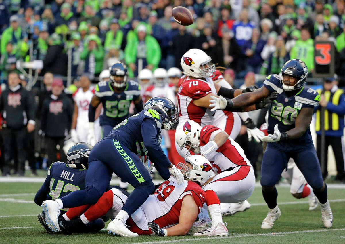 DEFENSE KEPT SEAHAWKS AFLOAT While Seattle's offense was largely inconsistent, it was the defense that gave the home team the chance to win. Bradley McDougald, who played free safety in place of the injured Tedric Thompson, set the tone with a near interception on the Cardinals' first play/throw of the game. Seattle's defense proceeded to erase a touchdown opportunity in the red zone on that opening drive to force a field goal. Arizona quarterback Josh Rosen was sacked six times and hit seven times overall. Defensive end Frank Clark (3 QB hits, TFL, FF, FR) and defensive tackle Jarran Reed (TFL) had two sacks apiece. Rookie Jacob Martin had his second career sack and a forced fumble, and DT Quinton Jefferson (TFL, FR) had the sixth sack. Rosen was held to 18-of-34 (52.9 percent) for 149 yards, a touchdown and a lowly 74.3 passer rating.