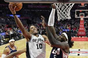 Spurs guard DeMar DeRozan shoots over Clippers forward Montrezl Harrell on Saturday, when DeRozan had 25 points and 13 rebounds in the Spurs' 122-111 victory.