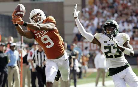 Texas wide receiver Collin Johnson (9) makes a catch in front of Baylor cornerback Derrek Thomas (23) for a 44-yard touchdown during the first half of an NCAA college football game, Saturday, Oct. 13, 2018, in Austin, Texas. (AP Photo/Eric Gay)
