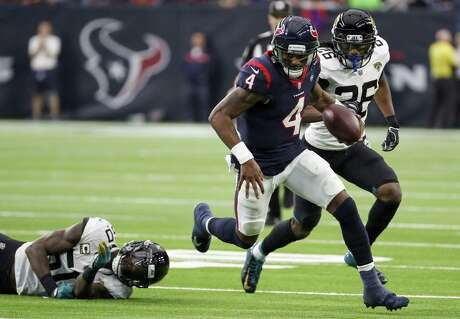 Houston Texans quarterback Deshaun Watson (4) breaks away from Jacksonville Jaguars outside linebacker Telvin Smith (50) as he runs outside during the second quarter of an NFL football game at NRG Stadium on Sunday, Dec. 30, 2018, in Houston.