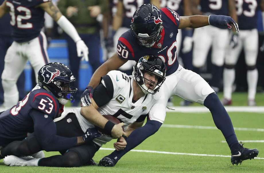 PHOTOS: NFL's best available free agents Houston Texans strong safety Justin Reid (20) and linebacker Duke Ejiofor (53) stop Jacksonville Jaguars quarterback Blake Bortles (5) short of a first time as he was forced out of the pocket during the second quarter of an NFL football game at NRG Stadium on Sunday, Dec. 30, 2018, in Houston. >>>See which players remain available during the NFL's free agency period ... Photo: Brett Coomer, Houston Chronicle / Staff Photographer / © 2018 Houston Chronicle