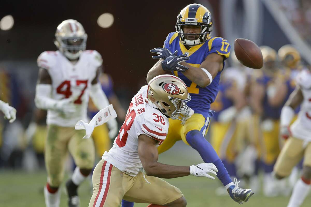 San Francisco 49ers strong safety Antone Exum breaks up a pass intended for Los Angeles Rams wide receiver Robert Woods during the second half in an NFL football game Sunday, Dec. 30, 2018, in Los Angeles. (AP Photo/Marcio Jose Sanchez)