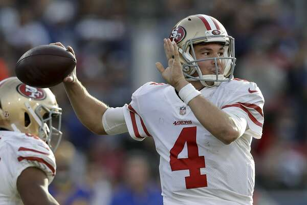 50b004377 1of2San Francisco 49ers quarterback Nick Mullens passes against the Los  Angeles Rams during the second half in an NFL football game Sunday