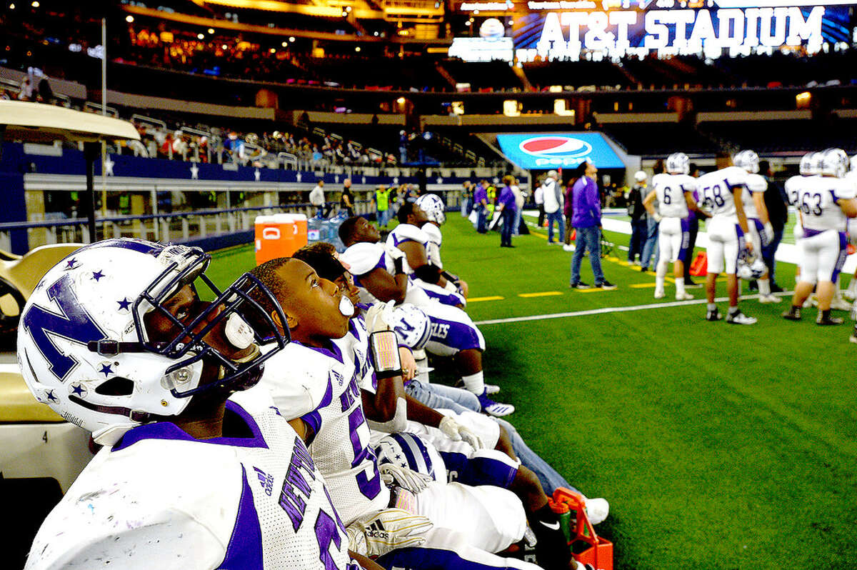 Newton's Michael Clark and teammates take in the game action with the Candians during their state final Class 3A Div. II game at AT&T Stadium. Photo taken Thursday, December 20, 2018 Kim Brent/The Enterprise