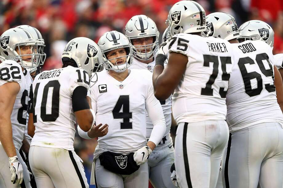 KANSAS CITY, MISSOURI - DECEMBER 30: Quarterback Derek Carr #4 of the Oakland Raiders huddles with teammates during the game against the Kansas City Chiefs at Arrowhead Stadium on December 30, 2018 in Kansas City, Missouri. (Photo by Jamie Squire/Getty Images) Photo: Jamie Squire / Getty Images