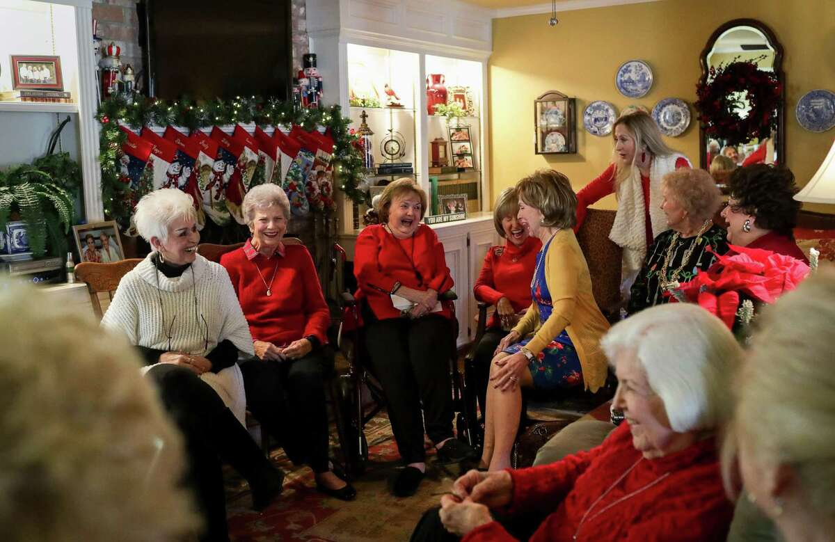 """Anniece Larkins, clockwise from left; Gwen Gerlich, Joyce Willoughby, Sue Carr, Wanda McKay, Crystal Womack (daughter of Sue Carr), Darla Williams, Gloria Floyd, and Charlotte Sterling recall funny moments from their youth, as they meet in the the elder Carr's living room in West Columbia. The women are part of a group, known as the """"Lucky 13,"""" many of whom have been friends since grade school."""