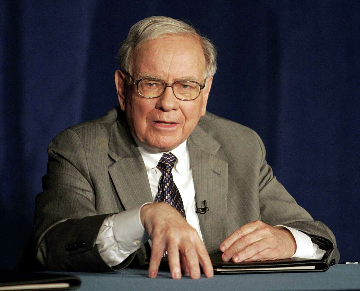 Warren Buffett speaks during a news conference, in this June 26, 2006, file photo in New York. In a Sept. 27 memo, Buffett issued a warning to top executives at his company, Berkshire Hathaway Inc., cautioning managers that many corporate scandals arise because questionable activity is accepted as normal behavior. He said the rationale that