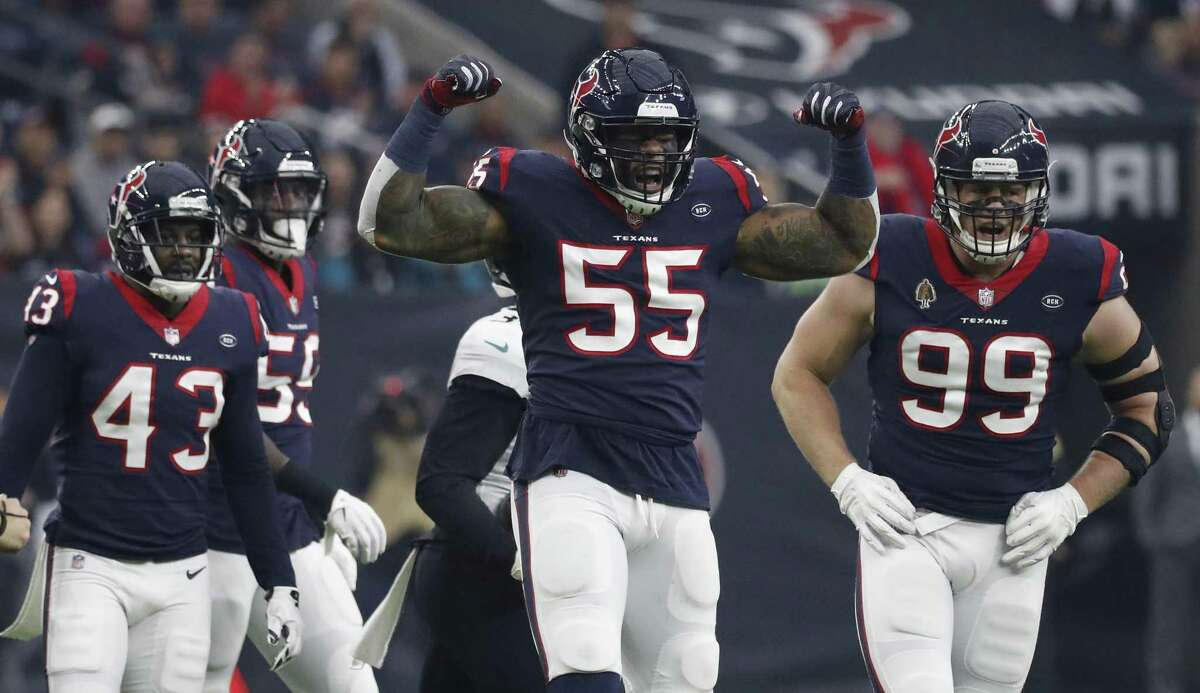 J.J. Watt, right, finished the regular season with 16 sacks - tops in the AFC. He also had 25 quarterback hits and led the NFL with seven forced fumbles.