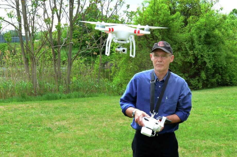 Vern Williams, assistant professor of journalism at Southern Connecticut State University, with one of his drones. Williams, former longtime photo director of the New Haven Register, died on Saturday, Dec. 29, 2018 after battling cancer. Photo: Contributed / SCSU - Jodie Mozdzer Gil