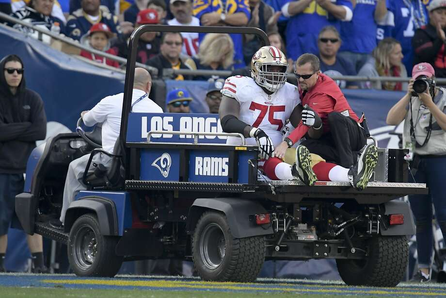 San Francisco 49ers offensive guard Laken Tomlinson is taken off the field after being hunt during the first half in an NFL football game against the Los Angeles Rams Sunday, Dec. 30, 2018, in Los Angeles. (AP Photo/Mark J. Terrill) Photo: Mark J. Terrill / Associated Press