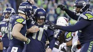 Seattle Seahawks' kicker Sebastian Janikowski is congratulated by teammates after kicking a field goal against the Arizona Cardinals during the second half of an NFL football game, Sunday, Dec. 30, 2018, in Seattle. The Seahawks won 27-24. (AP Photo/Ted S. Warren)