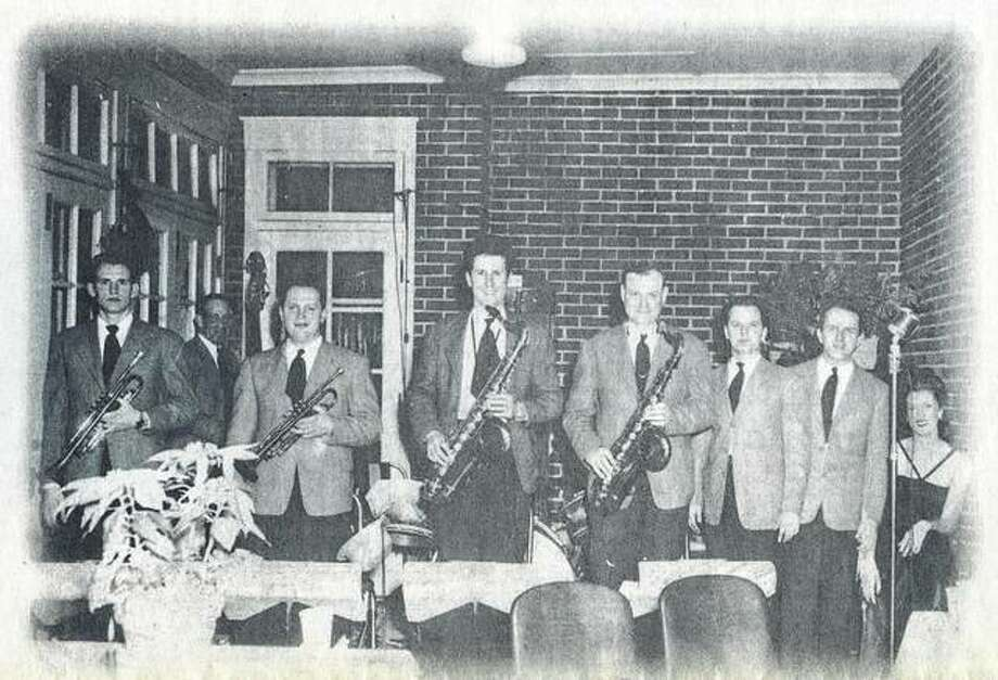 The Boots Brennan Orchestra takes a break from a performance on New Year's Eve 1945 at the Jacksonville Country Club. Glen Hawks (from left), Maurice Johnson, Earl Rabjohns, Gillie Combs, Lettsom Reid, Sammy Turner, Boots Brennan and Billie Plank. Photo: Photo Courtesy Of Sue Brennan Tapscott