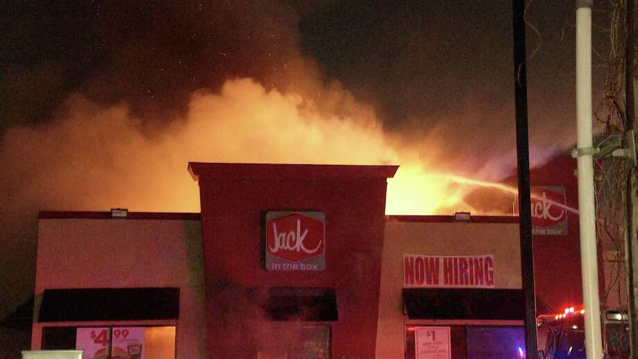 San Antonio Firefighters had trouble battling a fire that broke out at a Jack in the Box early Monday morning on the city's Northeast Side. Photo: Ken Branca