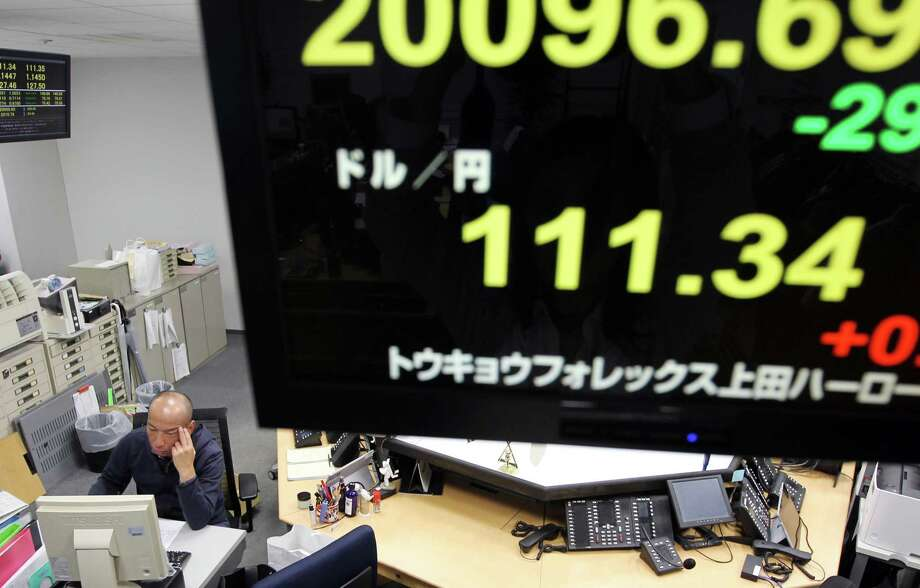 Employees Works Below A Monitor Displays The Exchange Rate Of Yen Against U S Dollar
