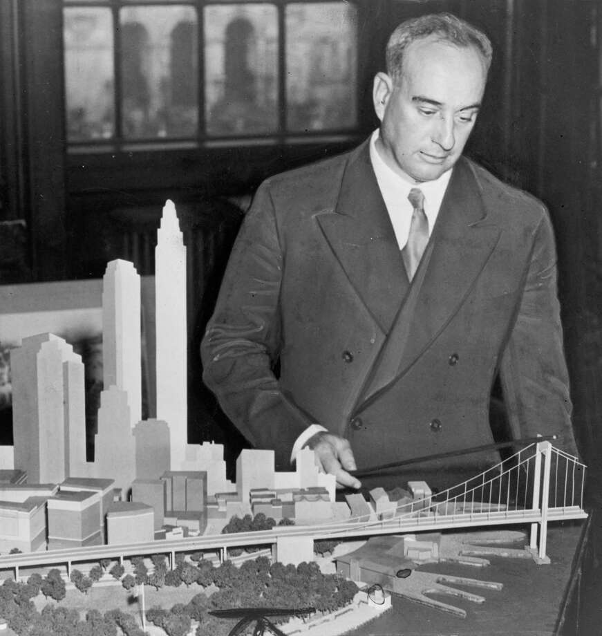 New York City Park Commissioner Robert Moses with a model of the proposed, but never built Brooklyn Battery Bridge in New York in 1939. Photo: C.M. Spieglitz / AP / AP