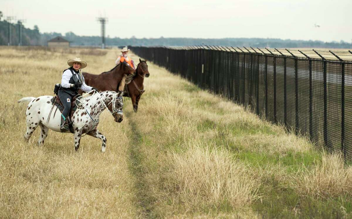 Airport Rangers Darolyn Butler, left, and Kelly Baber start their patrol along the perimeter fence at George Bush Intercontinental Airport on Monday, Dec. 17, 2018, in Houston. The Airport Rangers are mounted patrols that include off-duty law enforcement officers who ride their horses along the perimeter of the 13,000 acres of IAH including wooded trails.