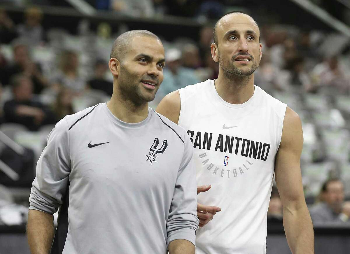 Tony Parker (left) and Manu Ginobili warm up beside one another before the Spurs' game against the Orlando Magic at the AT&T Center on Tuesday, Mar. 13, 2018.