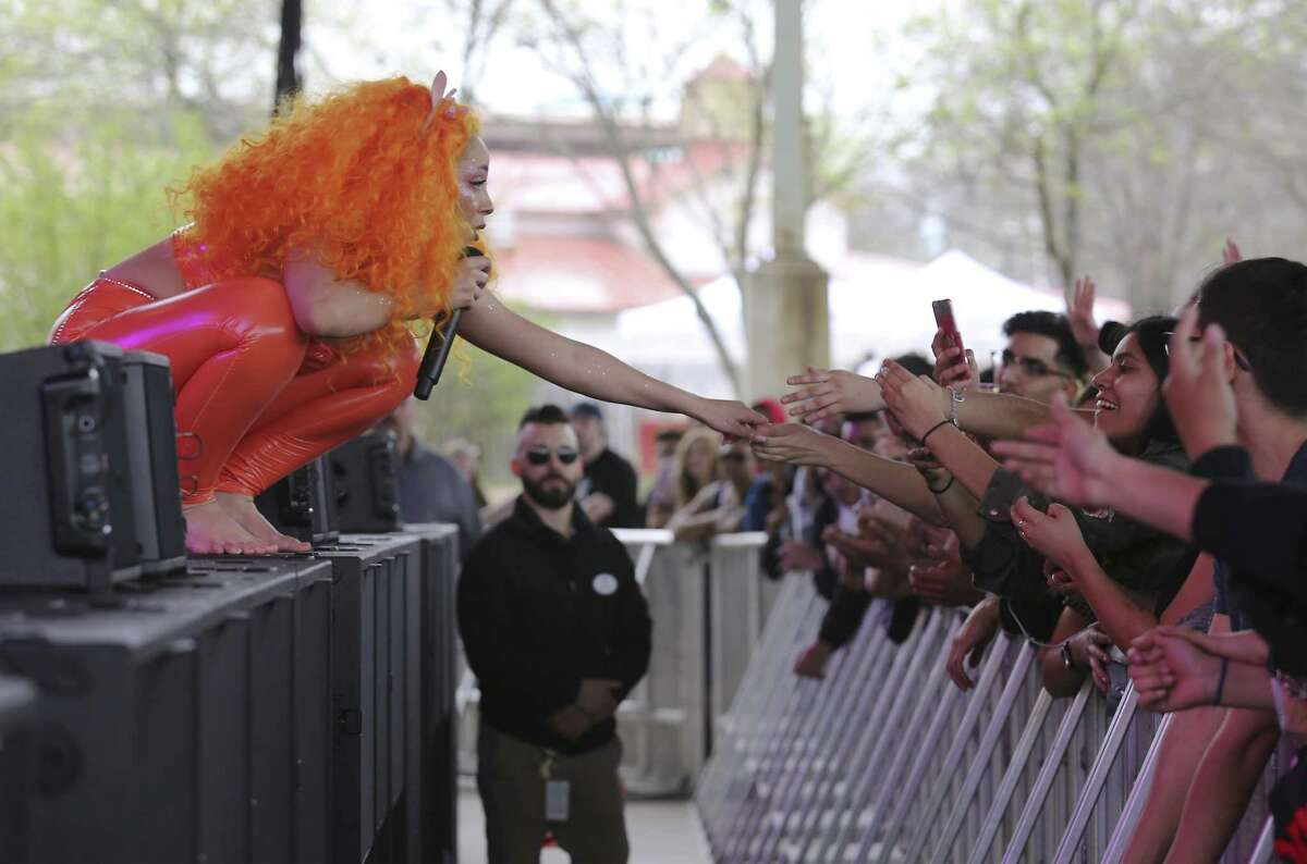 Los Angeles-based singer and rapper Doja Cat (left) reaches out to a fan during her show as The Botanica Music Festival kicks off its first year at Six Flags Fiesta Texas on Saturday, Mar. 3, 2018. The inaugural music event offered 30 music acts from student Mariachi bands to headliners such as Logic and Alessia Cara. Also in the mix was local rapper Blake who took the stage to roaring approval from fans. Botánica was launched by a group of San Antonio tech executives such as Securelogix's David Heard who co-founded the event. Tech leaders wanted to give the city a signature music event, much like the Austin City Limits Music Festival or Bonnaroo in Tennessee, in part to make it more attractive to young tech workers.