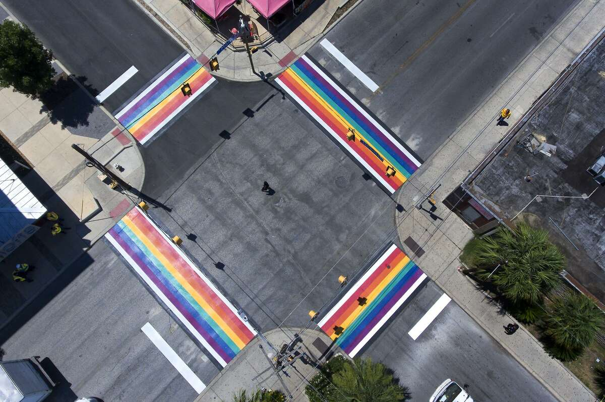 A city employee makes walks Wednesday, June 27, 2018 through the middle of the Main and Evergreen intersection near San Antonio College after the city of San Antonio finished a rainbow-themed set of crosswalks at the intersection