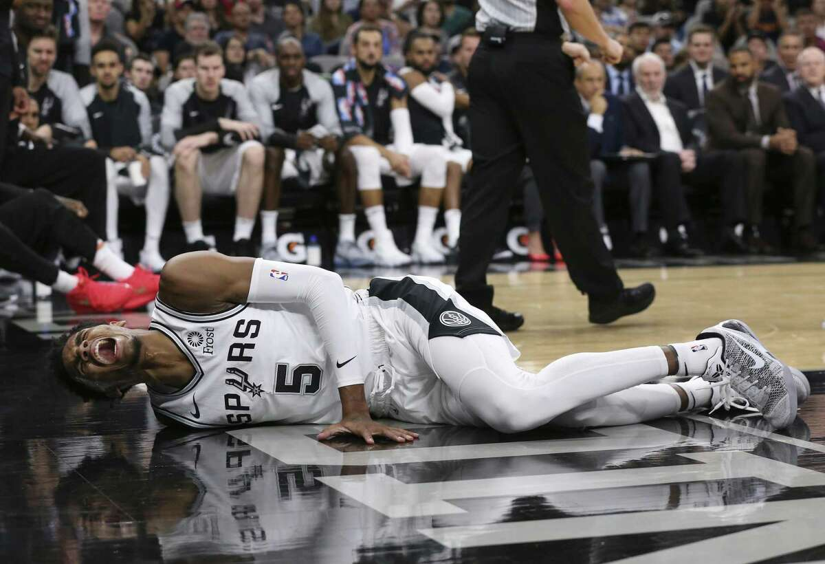 San Antonio Spurs' Dejounte Murray's season ended in the preseason when he suffered a torn ACL in his right knee.