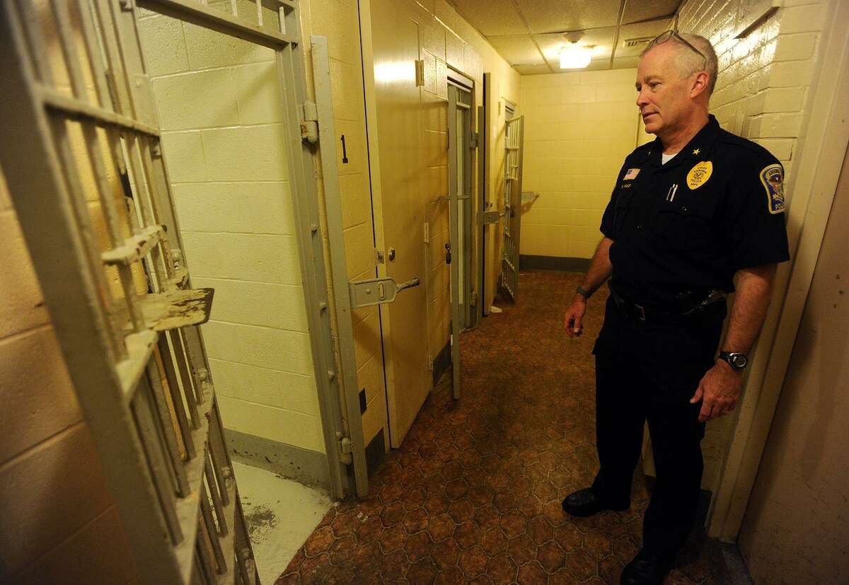 Ansonia Police Chief Kevin Hale gives a 2016 tour of the cellblock at the police station in the former Larkin School on 2 Elm Street. The city is in the process of renovating the former Farrel corporate headquaters on Main Street in a new police station.
