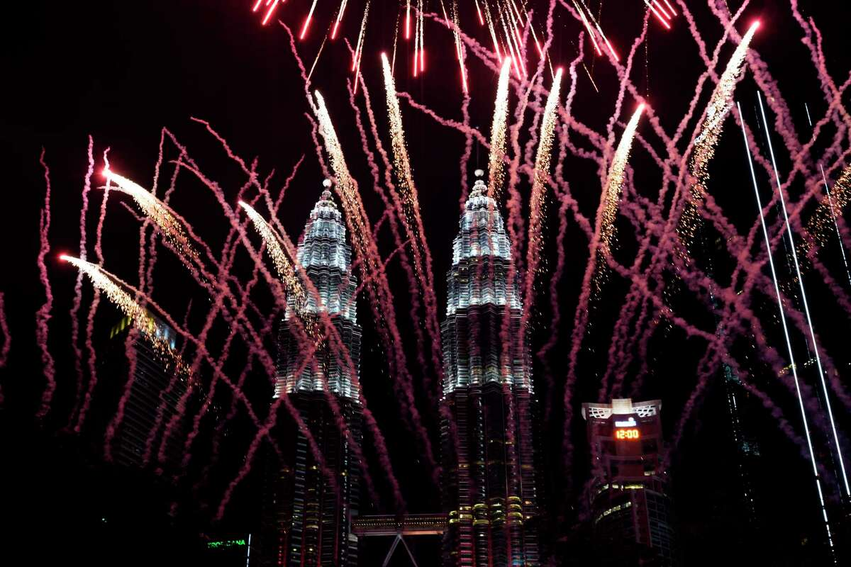 Fireworks explode in front of Malaysia's landmark building, the Petronas Twin Towers, during the New Year's celebration in Kuala Lumpur, Malaysia, Tuesday, Jan. 1, 2019.