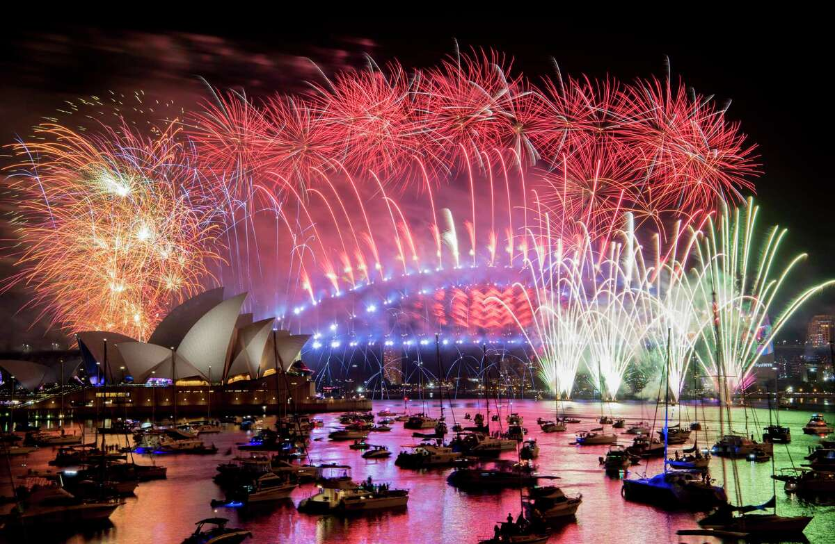 Fireworks explode over the Sydney Harbour during New Year's Eve celebrations in Sydney, Tuesday, Jan. 1, 2019. (Brendan Esposito/AAP via AP)