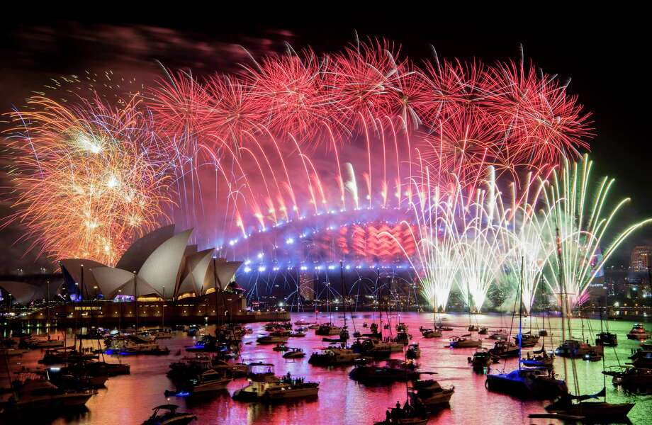 Fireworks explode over the Sydney Harbour during New Year's Eve celebrations in Sydney, Tuesday, Jan. 1, 2019. (Brendan Esposito/AAP via AP) Photo: BRENDAN ESPOSITO, AP / AAP