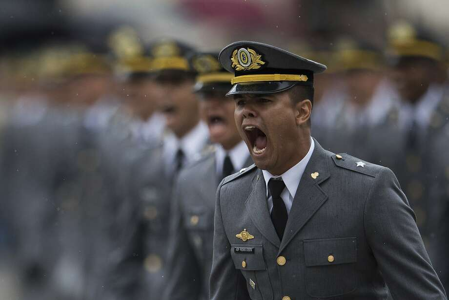 An Army cadet sings while marching during his graduation ceremony Dec. 1 at Agulha Negras Military Academy in Resende. President-elect Jair Bolsonaro graduated from the academy. Photo: Leo Correa / Associated Press 2018