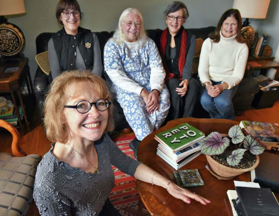 Poet Dawn Marar, foreground with members of the the Evergreen Poets Workshop, from left, Ellen White Rook, Dianne Sefcik, Linda Sonia Miller and Marea Gordett Thursday Nov. 15, 2018 in Delmar, NY.   (John Carl D'Annibale/Times Union) Photo: John Carl D'Annibale / 40045319A