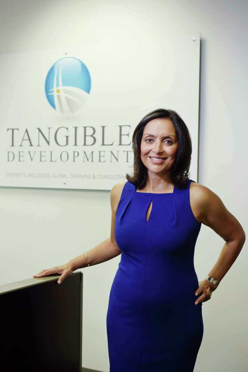 Sujata Chaudhry, founder and CEO of Tangible Development, poses for a photo at her office on Tuesday, July 11, 2017, in Latham, N.Y. (Paul Buckowski / Times Union)