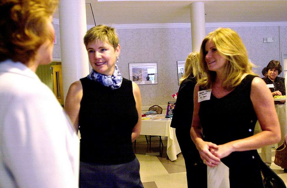 Times Union photo by STEVE JACOBS ,7/1/03, Colonie,NY-- HOSTING AUTHOR -- Author Sally Helgesen ,center, speaks to a visitor at the Albany-Colonie Regional Chamber's Womens Busines Council luncheon at the Lakeview restaurant, July 1,2003 At right is Maureen Simione, the chairman of the womens business council.( for business story) 1 of 3 photos