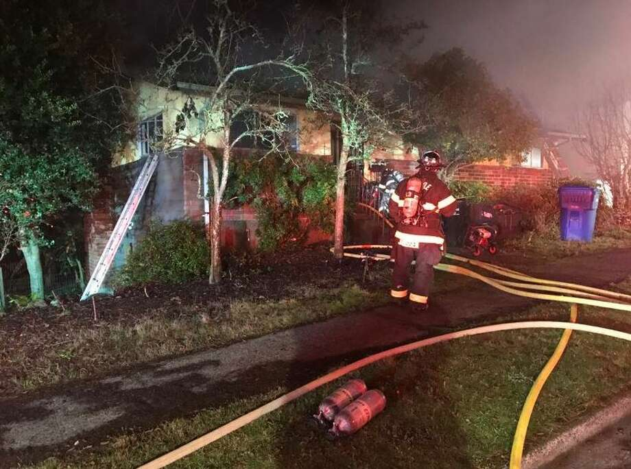 Two people were found dead in a fire that burned a home housing a marijuana grow in the 9200 block of Spear Pl S in South Seattle Monday morning. Photo: Courtesy Seattle Fire